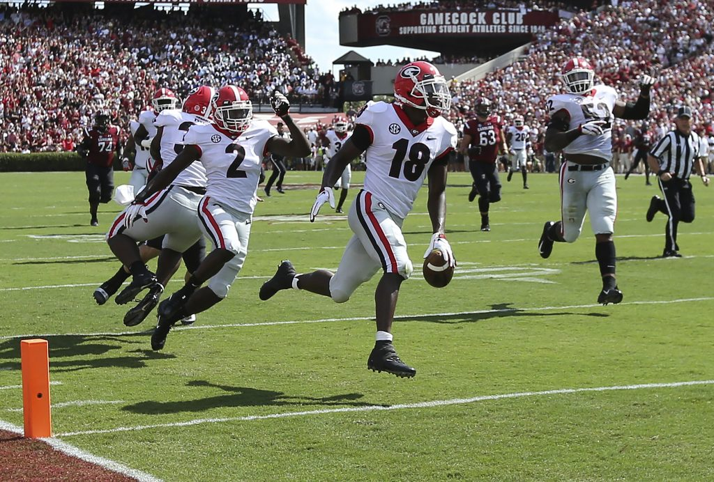 Georgia defensive back Deandre Baker returns an interception for a touchdown during the first quarter of the Bulldogs' 41-17 win over South Carolina on Saturday in Columbia, S.C.
