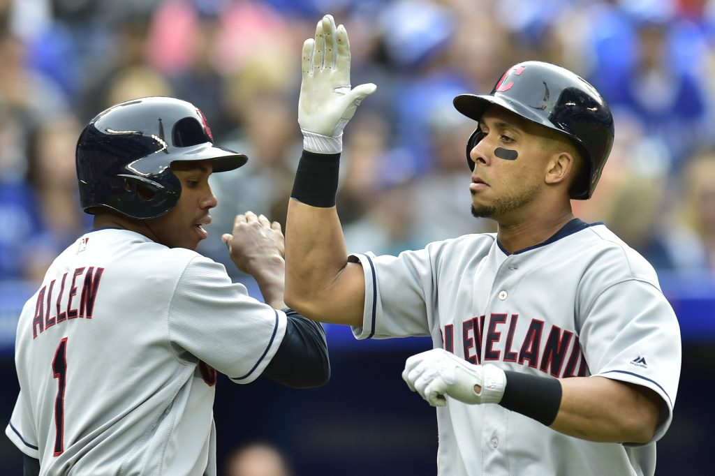 Cleveland Indians Michael Brantley, right, celebrates with Greg Allen after hitting a two-run home run in the fifth inning of the Indians' 9-8 win over Toronto on Saturday in Toronto.