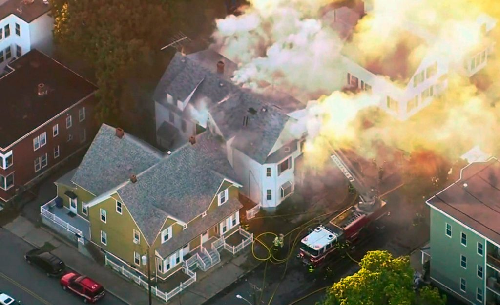 In this image take from video provided by WCVB in Boston, firefighters battle a large structure fire Thursday in Lawrence, Mass. On Friday, Unitil, which provides natural gas to southwestern Maine, said it intends review its systems once the cause of the Massachusetts explosions has been determined.