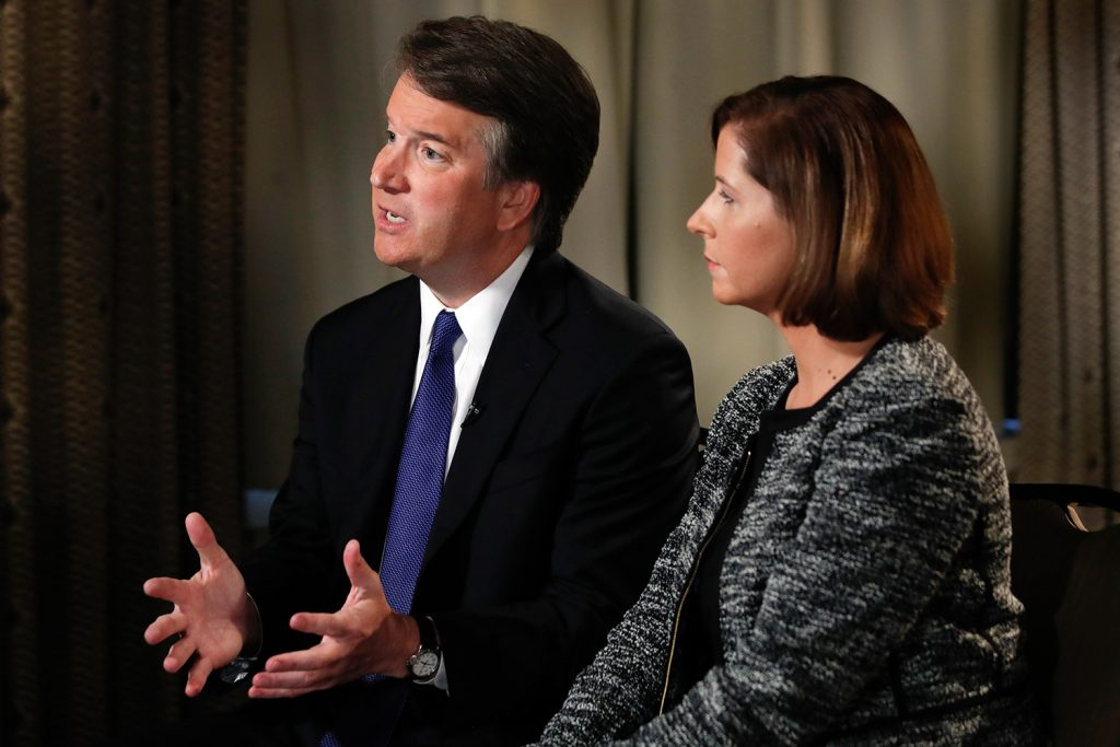 "Brett Kavanaugh, with his wife, Ashley Estes Kavanaugh, answers questions during a Fox News interview Monday in Washington about allegations of sexual misconduct against the Supreme Court nominee. Kavanaugh accused his opponents of launching ""smears, pure and simple."""