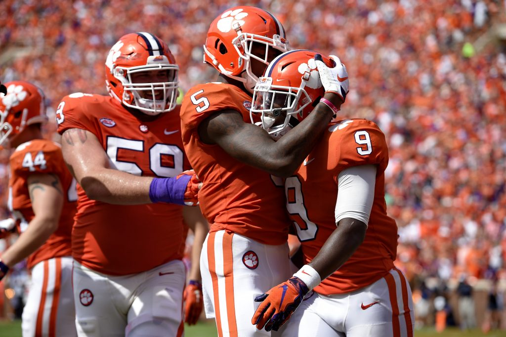 Clemson's Travis Etienne, right, celebrates his touchdown with Tee Higgins, center, and Gage Cervenka during the second half of the TIgers' 27-23 win over Syracuse on Saturday in Clemson, South Carolina.