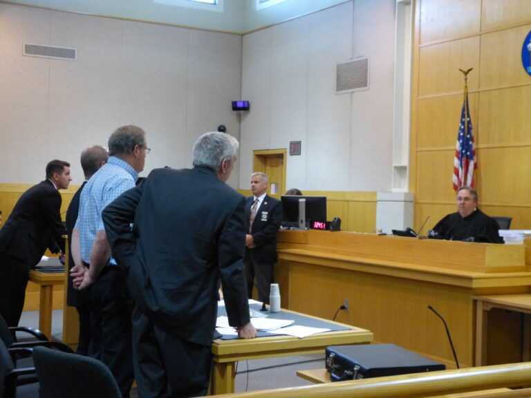 Justice Daniel Billings sentences Robert Welch of Topsham, standing third from left with hands behind his back, to 10 years incarceration and six years of probation, in West Bath District Court on Wednesday.