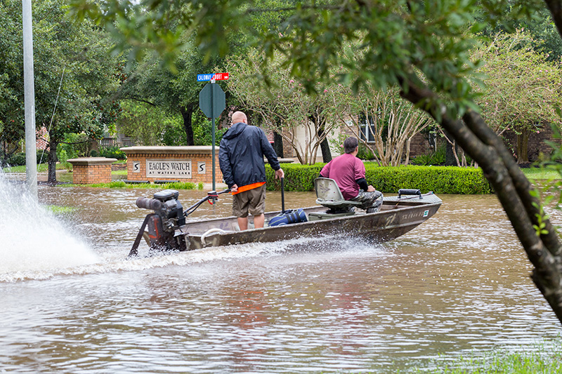 Cajun Navy volunteers from Austin ride a boat in a flooded street in Missouri City Texas after Hurricane Harvey in August 2017.