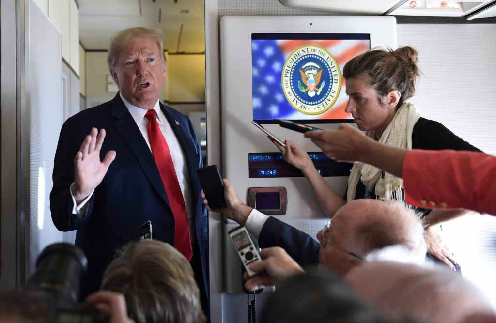 President Trump speaks to reporters on Air Force One on Friday.