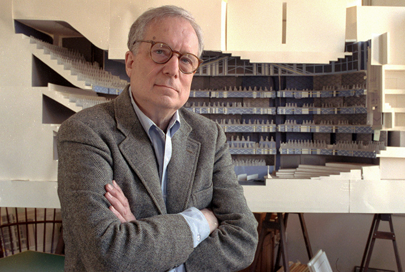 Robert Venturi poses in his office in Philadelphia, with a model of a new hall for the Philadelphia Orchestra in background in 1991.