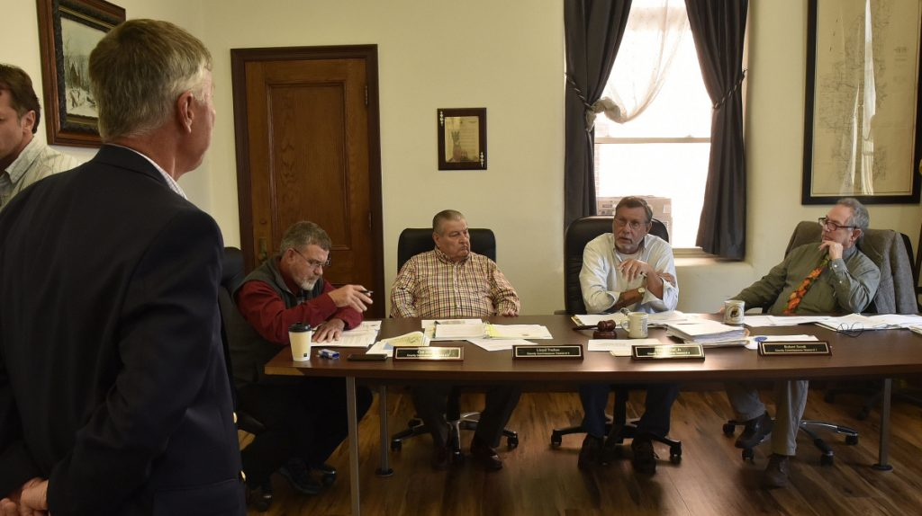 John Carroll, spokesman for CMP, addresses Somerset County commissioners, from left, Cyp Johnson, Lloyd Trafton, Newell Graff Jr. and Robert Sezak, on Wednesday.