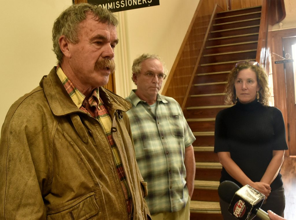 Pete Dostie, left, John Willard and Tania Merette all express opposition to the CMP New England Clean Energy Corridor project during a Somerset County commissioners meeting in Skowhegan on Wednesday.