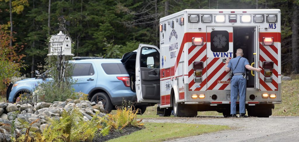 Maine State Police and Winthrop Ambulance attend to a stabbing victim Sunday at a residence on the Beaver Dam Road in Readfield.