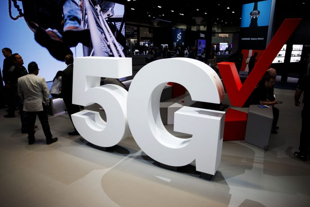 Verizon 5G wireless signage is displayed at the company's booth during the Mobile World Congress Americas in Los Angeles on Sept. 12. MUST CREDIT: Bloomberg photo by Patrick T. Fallon