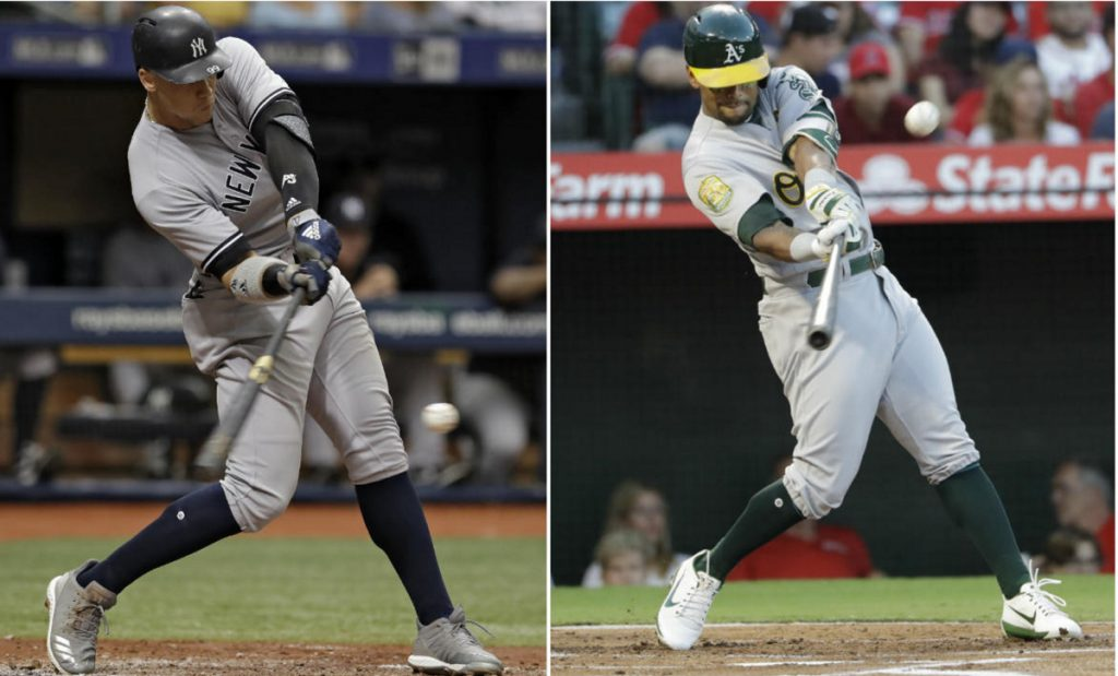 Aaron Judge, left, was part of a Yankees lineup that set the major league record for homers in a season. The A's Khris Davis led the majors with 48 homers.