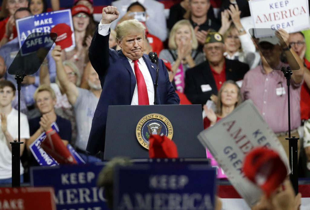 President Donald Trump acknowledges the crowd as he finishes speaking at a rally Monday, Oct. 1, 2018, in Johnson City, Tenn. (AP Photo/Mark Humphrey)
