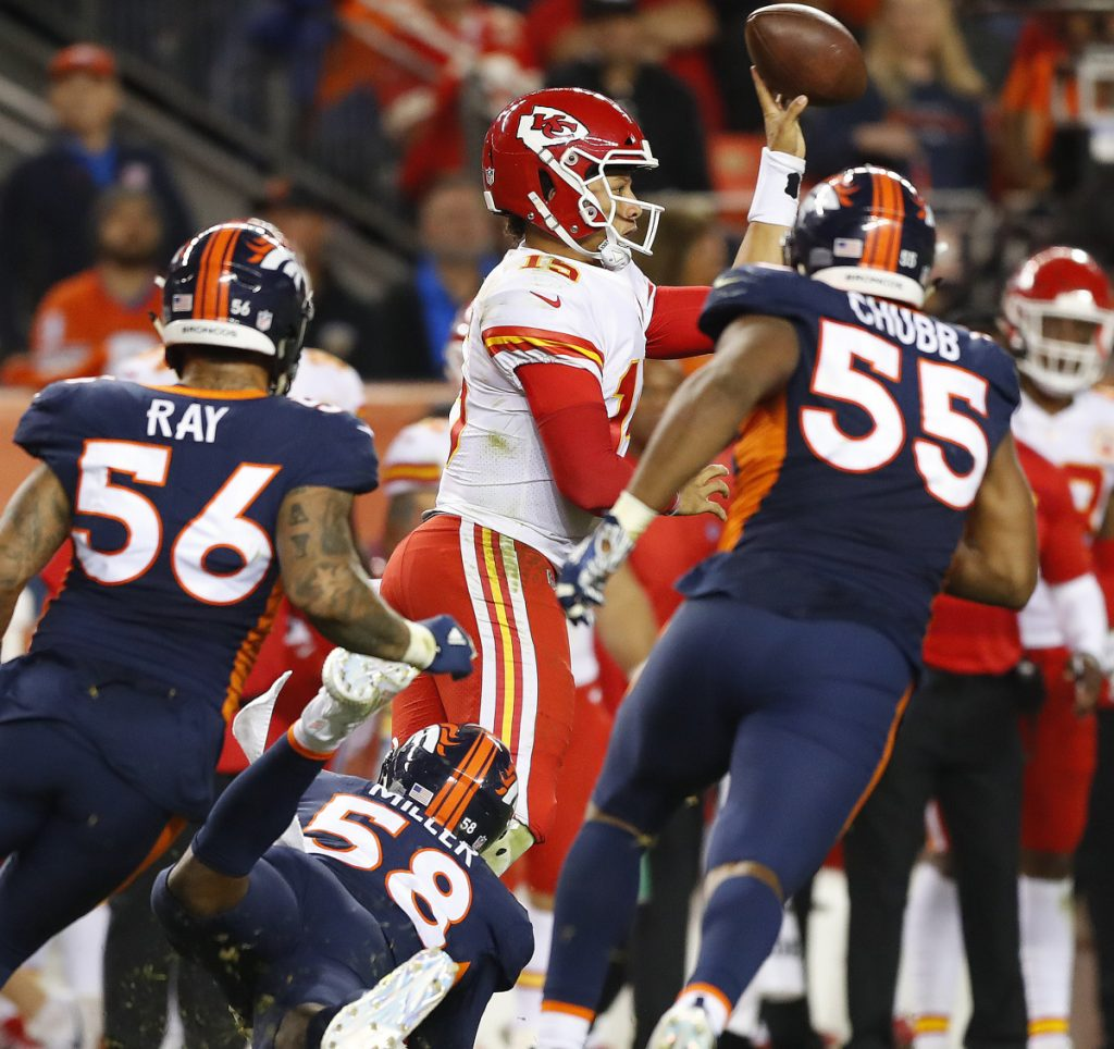 Chiefs quarterback Patrick Mahomes makes a left-handed throw for a first down late in the fourth quarter to help Kansas City to a 27-23 win over the Denver Broncos on Monday night.