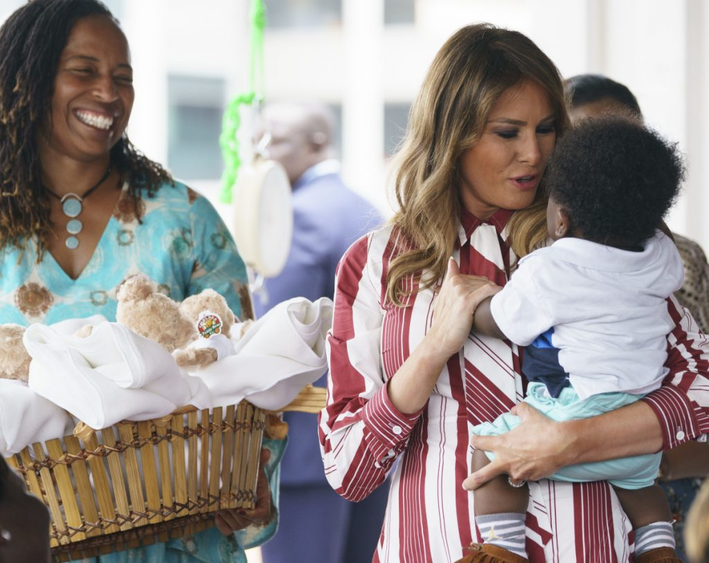 First lady Melania Trump holds a baby as she visits Greater Accra Regional Hospital in Accra, Ghana, on Tuesday. She's also going to Kenya, Malawi and Egypt.