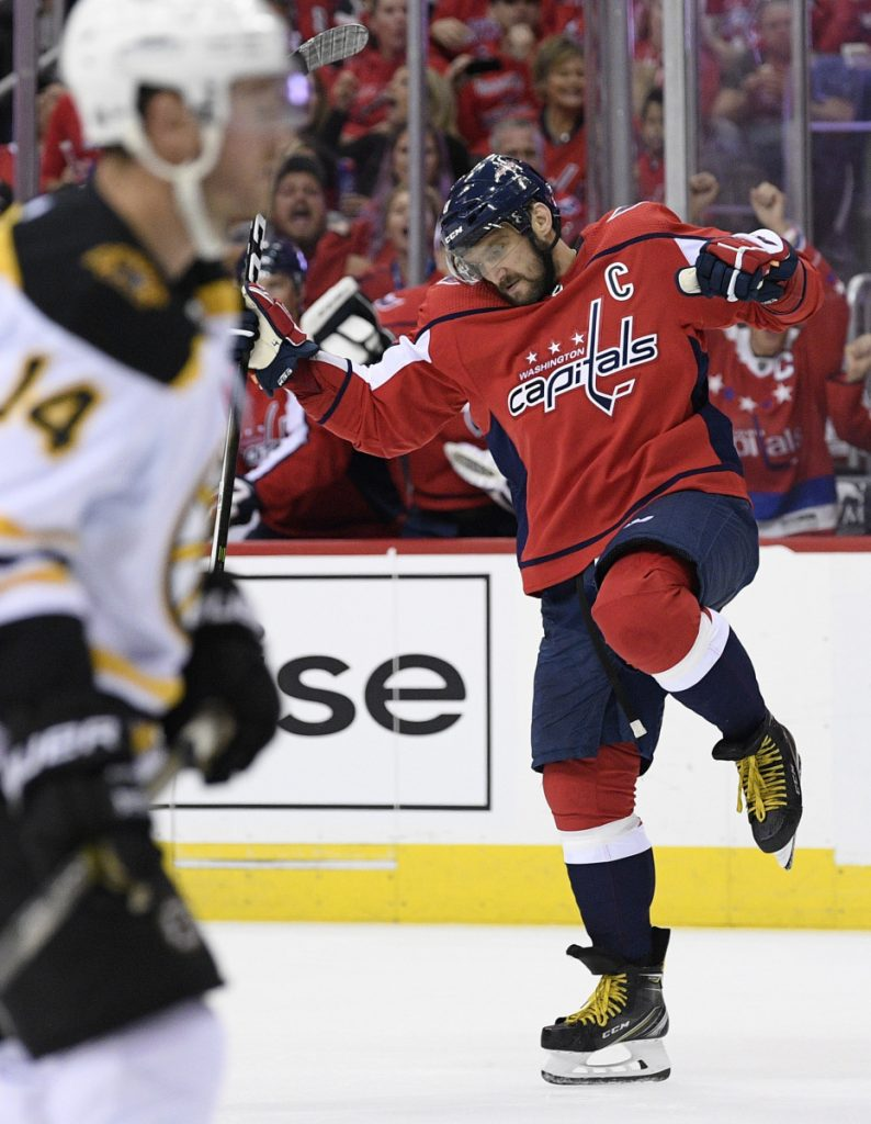 Capitals left wing Alex Ovechkin celebrates his second-period goal against the Boston Bruins on Wednesday night in the NHL season opener at Washington. The defending Stanley Cup champs scored just 24 seconds into the game to begin the rout.
