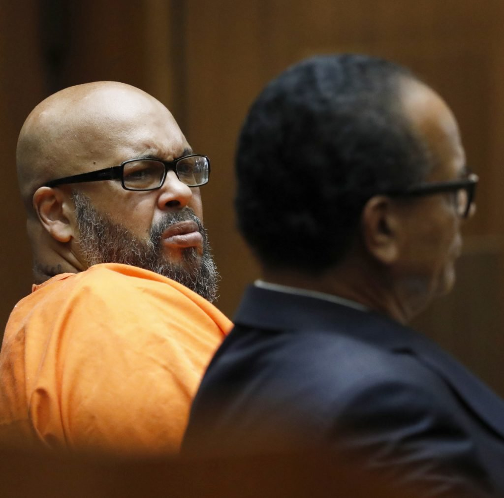 "Marion ""Suge"" Knight, left, pleads no contest to voluntary manslaughter and agrees to a prison sentence of 28 years."