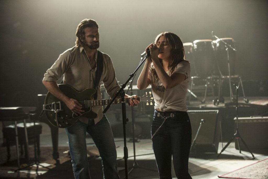 "Bradley Cooper and Lady Gaga in a scene from the latest reboot of ""A Star Is Born,"" Cooper's directorial debut."