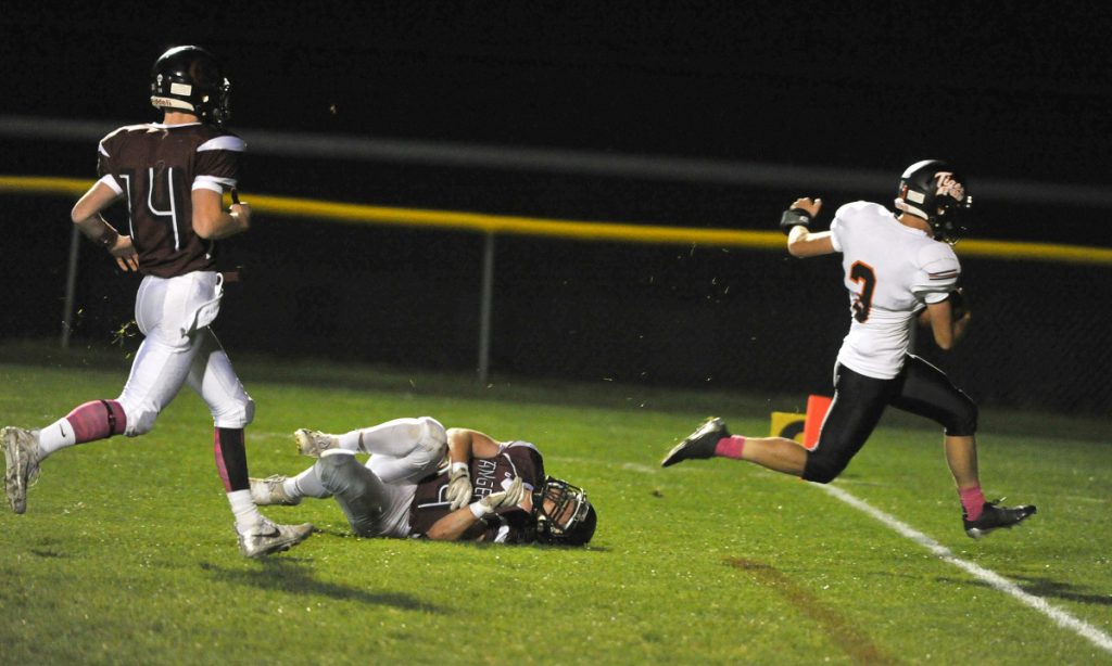 Biddeford's Scott Kelly evades the diving tackle attempt by Greely's Jackson Williams to score a touchdown in the first quarter Friday night.