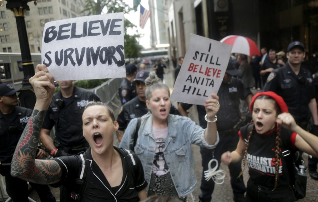 Protesters rally in front of Trump Tower in New York on Thursday against Supreme Court nominee Brett Kavanaugh.