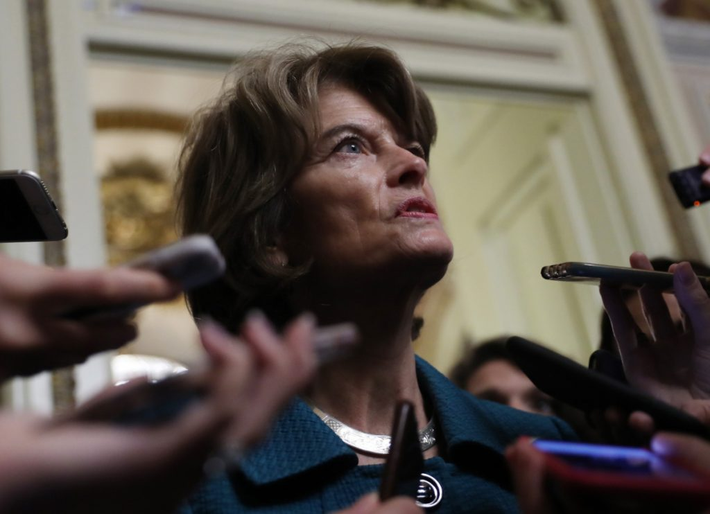 Sen. Lisa Murkowski, R-Alaska, speaks to the media on Capitol Hill on Friday.