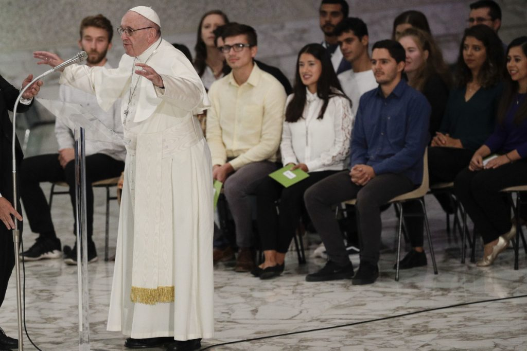Pope Francis delivers his message in the Paul VI Hall as he meets with youths attending the Synod during an audience at the Vatican on Saturday.