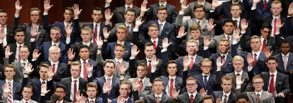 "Mormons participate in a custom called a ""sustaining"" when Latter-day Saints stand and raise their hands during the conference of The Church of Jesus Christ of Latter-day Saints."