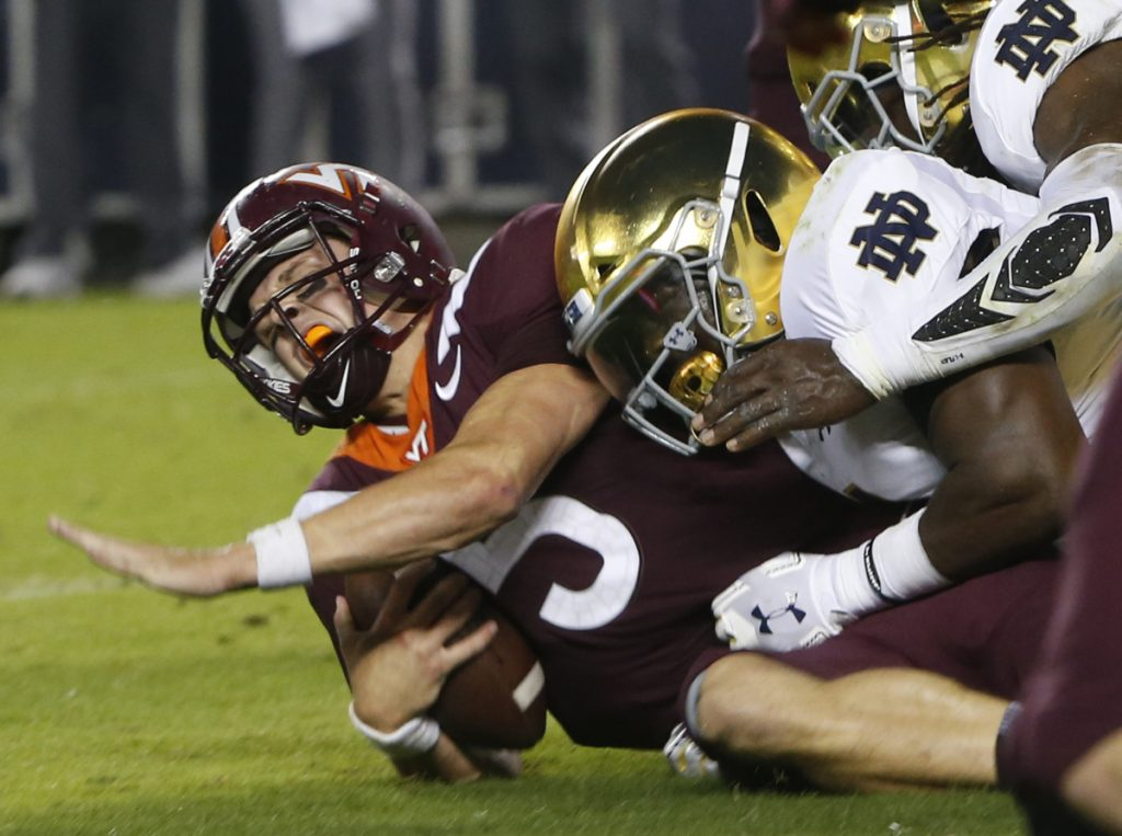 Virginia Tech quarterback Ryan Willis is slammed to the ground on third down near the goal line during the first half Saturday night in Blacksburg, Va. The No. 6-ranked Fighting Irish broke the game open in the second half.