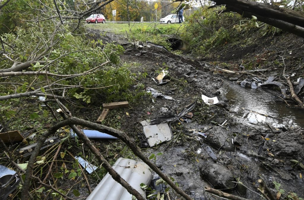 Debris scatters an area Sunday, Oct. 7, 2018, at the site of yesterday's fatal crash Schoharie, N.Y.