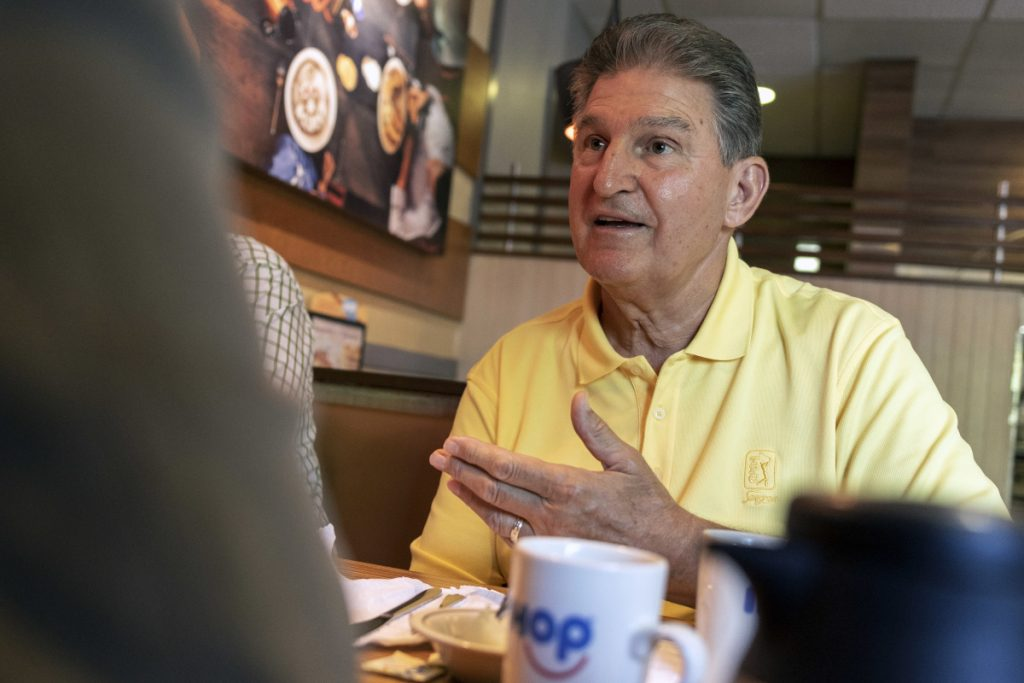 Democratic Sen. Joe Manchin speaks on Sunday at an IHOP restaurant in Charleston