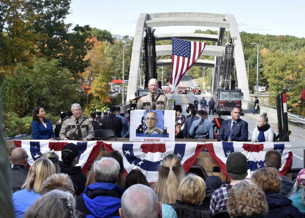 Somerset County Sheriff Dale Lancaster addresses the hundreds people who attended the Corporal Eugene Cole Memorial Bridge dedication ceremony in Norridgewock on Sunday.