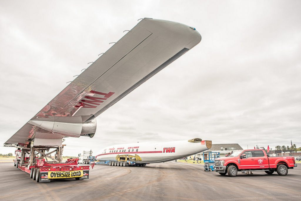The wings, body and tail of the rare aircraft will travel as part of a six-truck, mile-long convoy to Queens to become part of the TWA hotel complex.