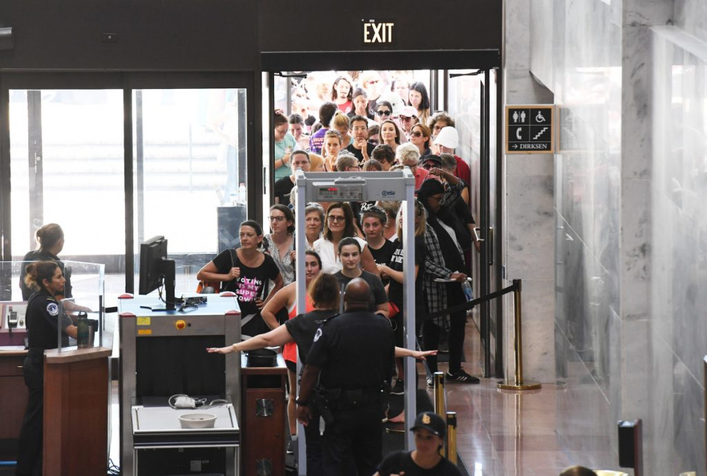 People go through security as they begin to gather at the Hart Senate Office Building in Washington, D.C., during a Thursday rally against Brett Kavanaugh.