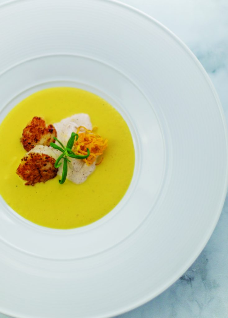 Pumpkin Soup with Seared Diver Scallops and Chinese Five-Spice Cream.