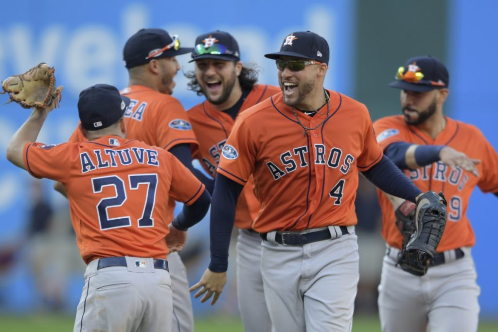 The Astros celebrate after sweeping the Indians in the ALDS on Monday. In the three wins, Houston outscored Cleveland 21-6 and outhit them, .327 to .144 with eight home runs.