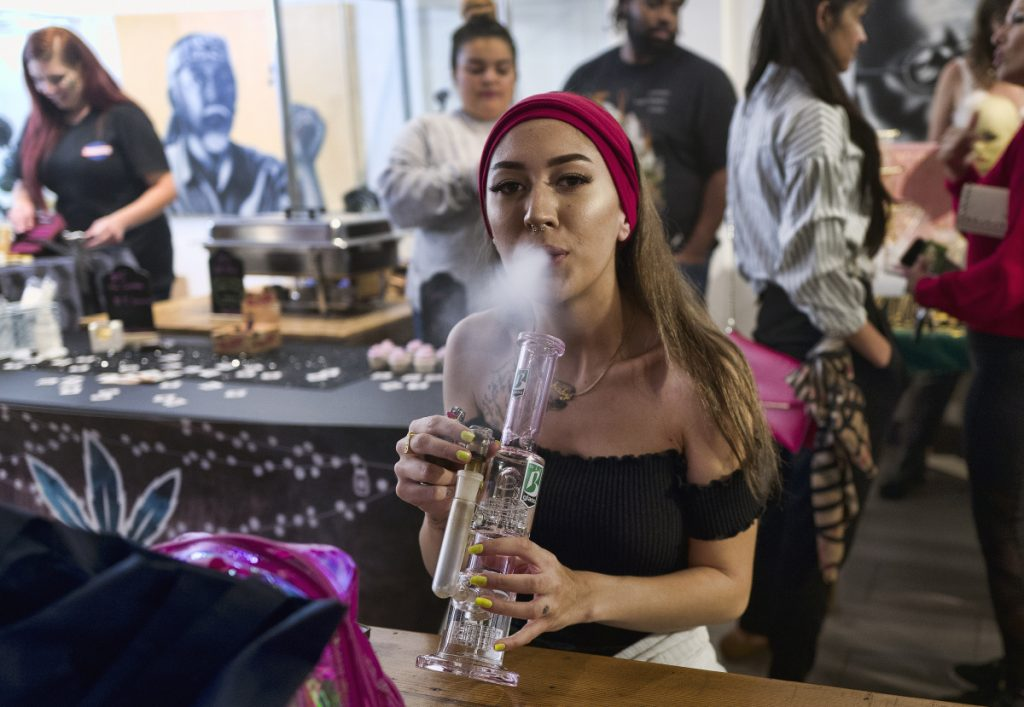 Nicole Kahamneian takes a hit at the Hitman Coffee Shop in Los Angeles last month. Two years ago, California voters approved a ballot measure legalizing marijuana. Advocates are hoping voters in the Midwest are ready to do the same.