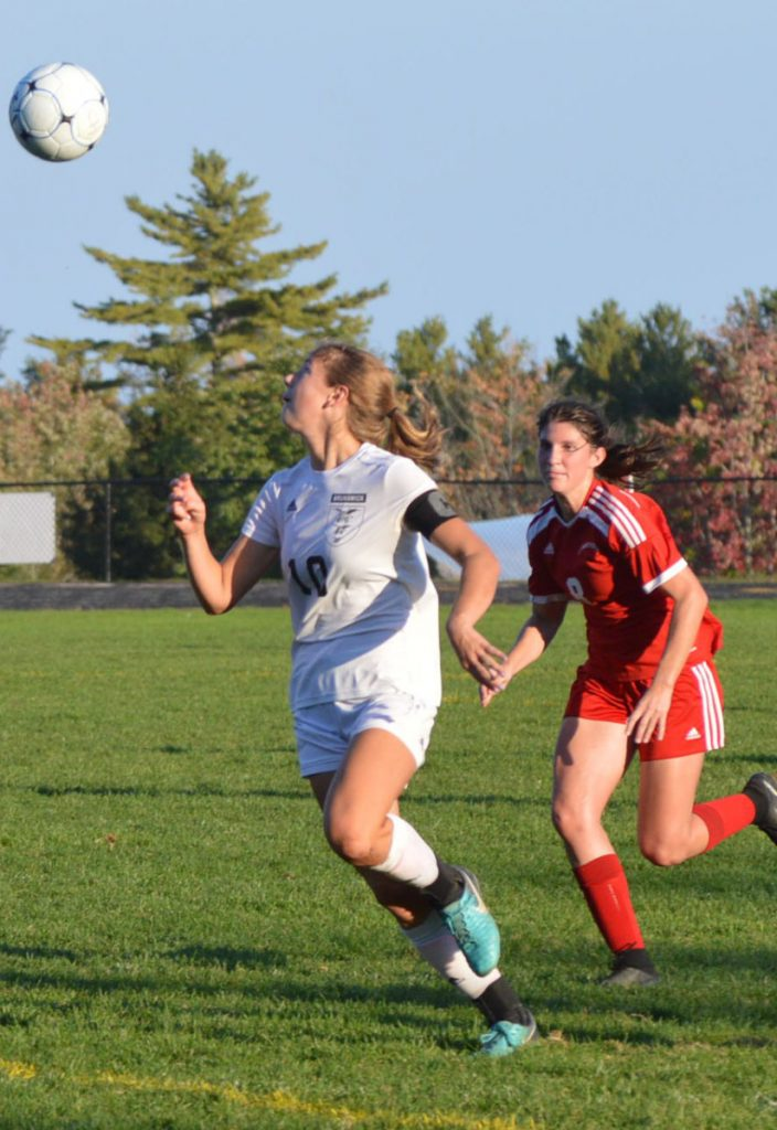 Brunswick's Izzy Banks prepares to receive a pass off a direct kick as Camden Hills' Sarah Spizzuouco pursues in Tuesday's game at Rockport. Unbeaten Camden Hills posted a 6-0 win.