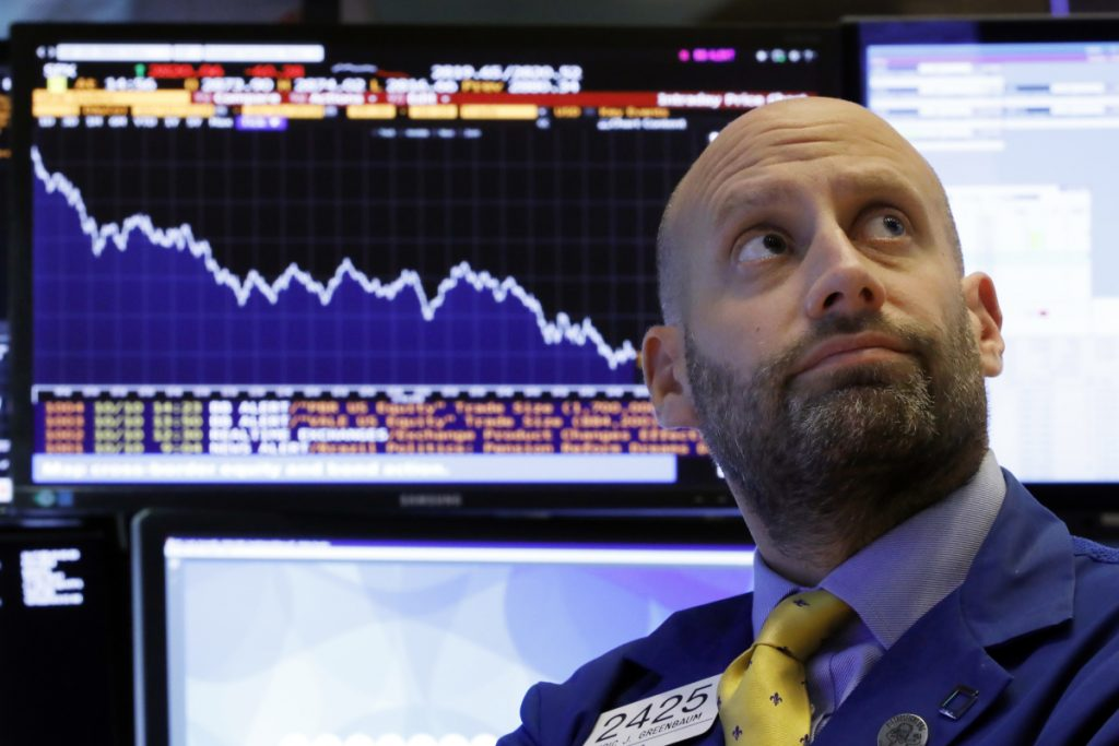 Specialist Meric Greenbaum works at his post on the floor of the New York Stock Exchange on Wednesday.