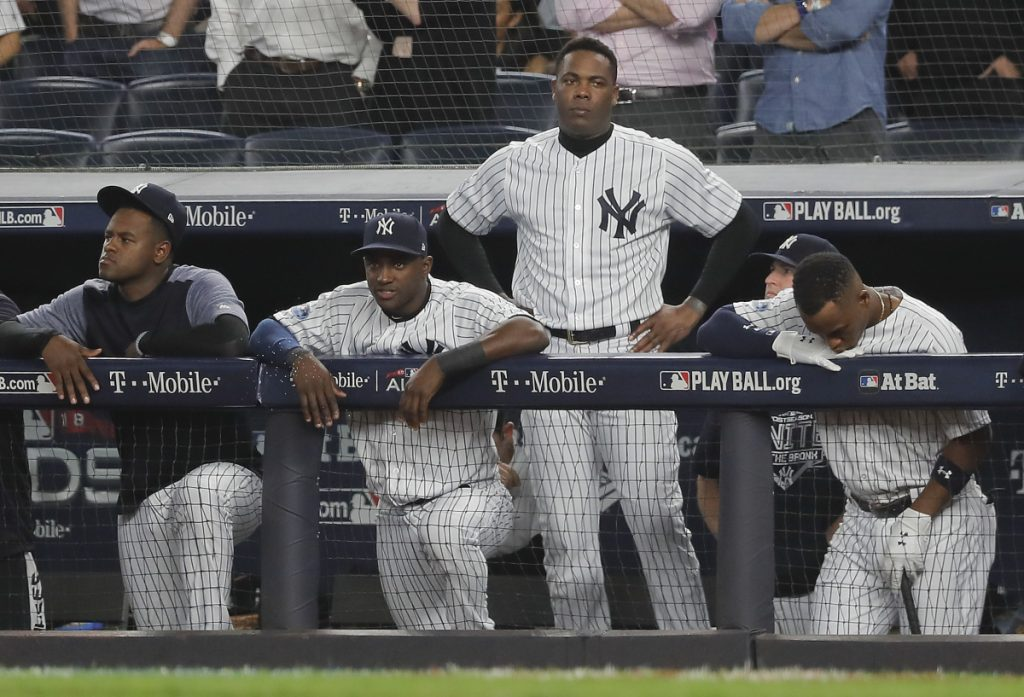 The Yankees watch from the dugout during the ninth inning of Game 4 of the ALDS against the Boston Red Sox on Tuesday.