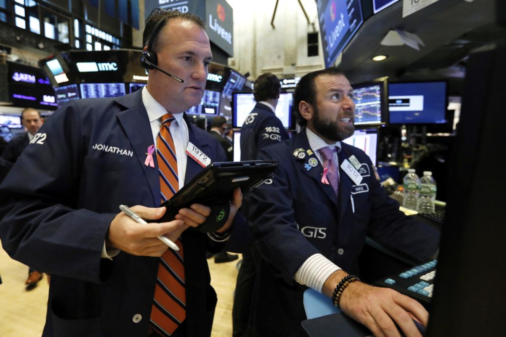 Trader Jonathan Corpina, left, and specialist Michael Pistillo work on the floor of the New York Stock Exchange on Thursday. The Dow Jones industrial average ended the day down 2.1 percent, or 546 points, to 25,052. It pushed the two-day loss to nearly 1,400 points.