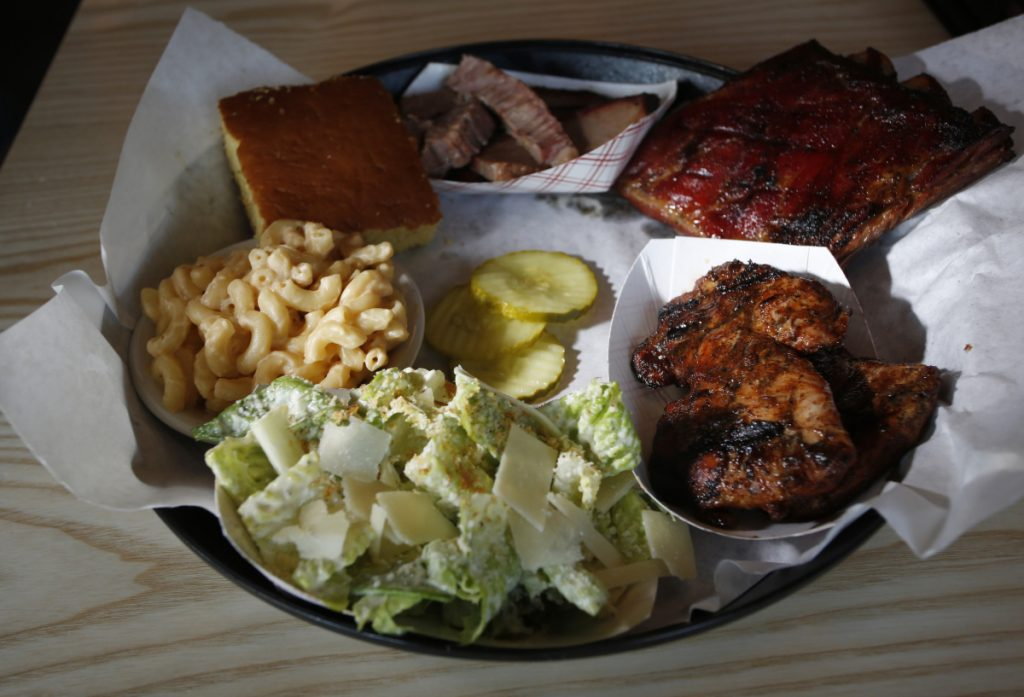 This combo plate featured slow-smoked chicken, brisket and ribs with cornbread, mac and cheese and Caesar salad.