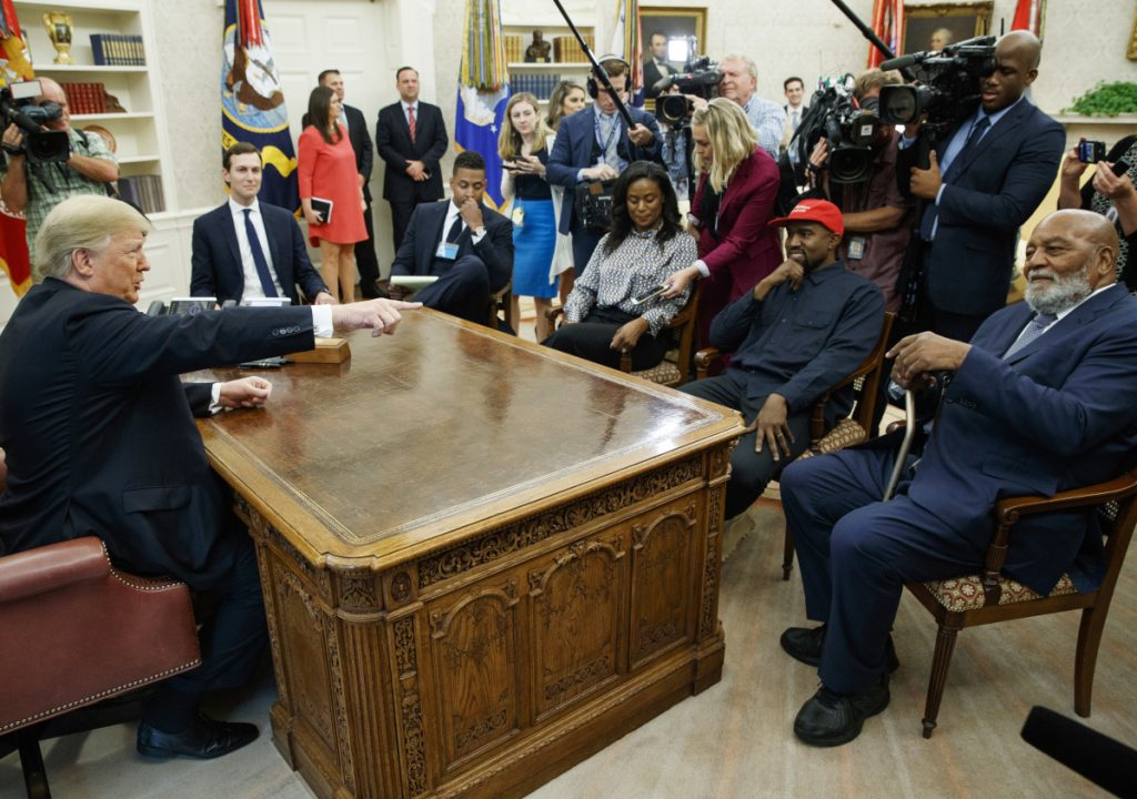 President Trump meets Thursday with rapper Kanye West and Jim Brown, an ex-NFL player, in the Oval Office. The low unemployment rate among African-Americans was one of the issues they discussed.