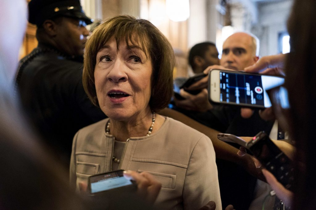 Sen. Susan Collins talks to journalists after speaking in favor of Brett Kavanaugh on Oct. 5. The jury is still out on which party, if either, the Kavanaugh fight will help in midterms in Maine.
