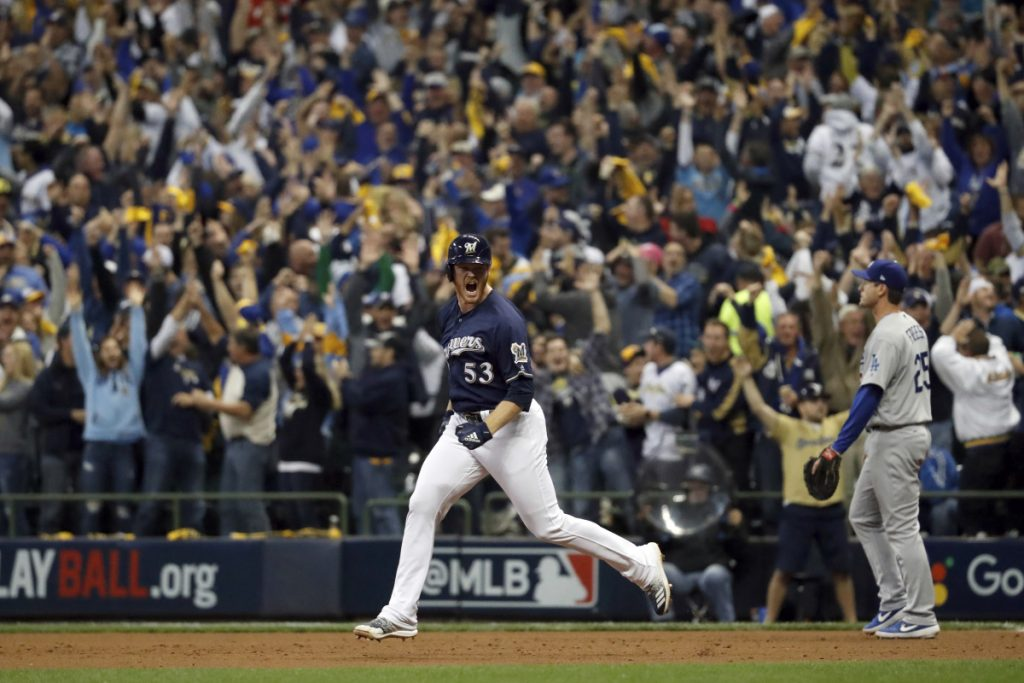 Milwaukee reliever Brandon Woodruff celebrates after hitting a home run during the third inning against Los Angeles on Friday in Milwaukee. The Brewers beat the Dodgers, 6-5 to take Game 1 of the series.