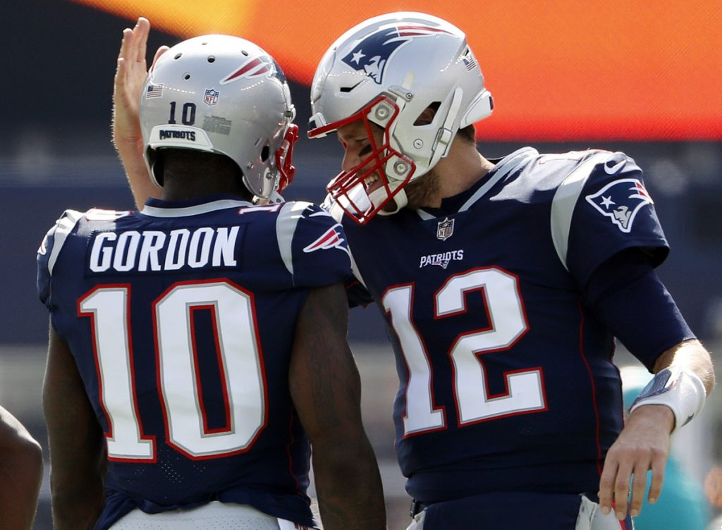 Josh Gordon, left, is continuing to learn the playbook, and it doesn't hurt that his locker is right next to Tom Brady's. Since his trade from Cleveland, Gordon has four catches for 82 yards and a touchdown.