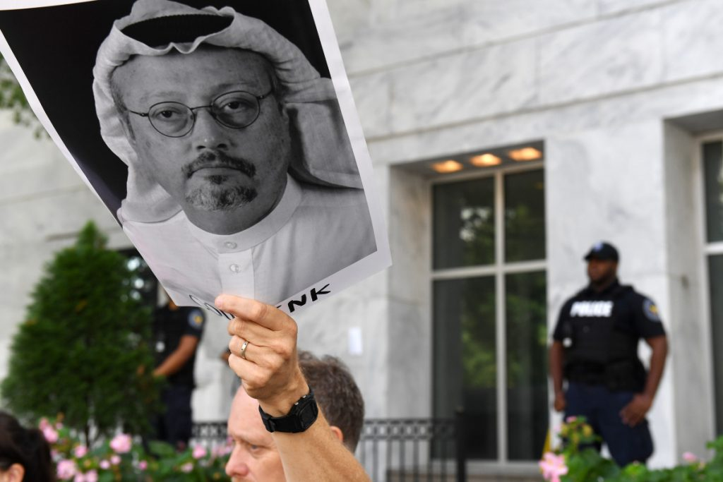 Michael Beer holds a poster during a rally about the disappearance of Washington Post journalist Jamal Khashoggi outside the Embassy of Saudi Arabia in Washington on Wednesday.