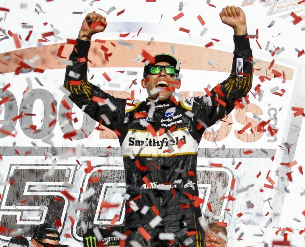 Aric Almirola celebrates his second career Cup Series win – and his first since 2014 – after he secured a spot in the next stage of the playoffs with a victory Sunday at Talladega Superspeedway.