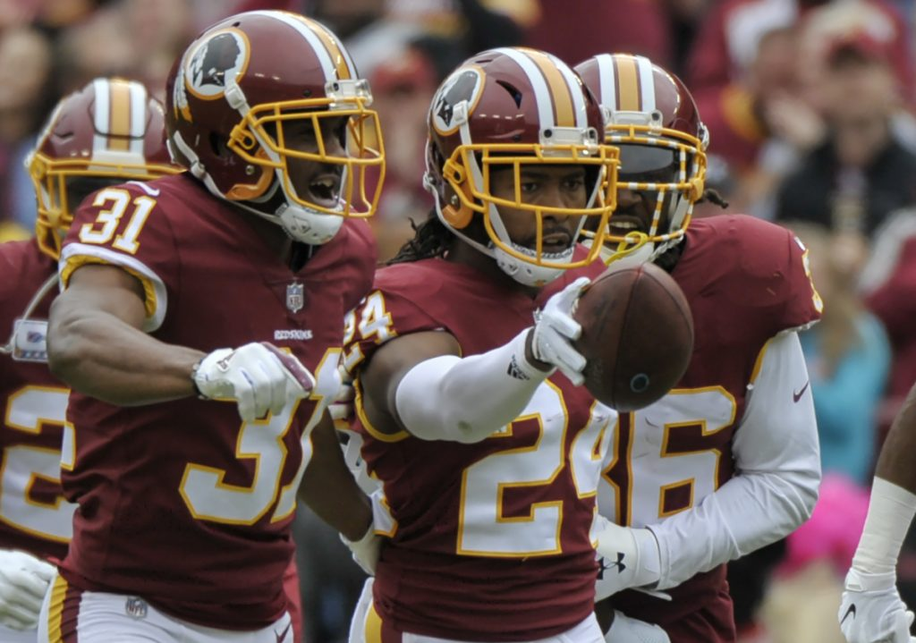 Washington cornerback Josh Norman, who was benched in a Monday night loss, came back strong Sunday, including this interception during a 23-17 victory against the Carolina Panthers.