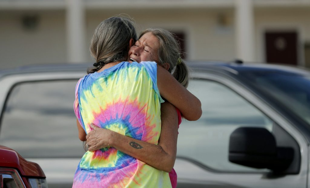 Nancy Register right weeps as she is comforted Wednesday by Roxie Cline after she lost her home to Hurricane Michael in Mexico Beach Fla