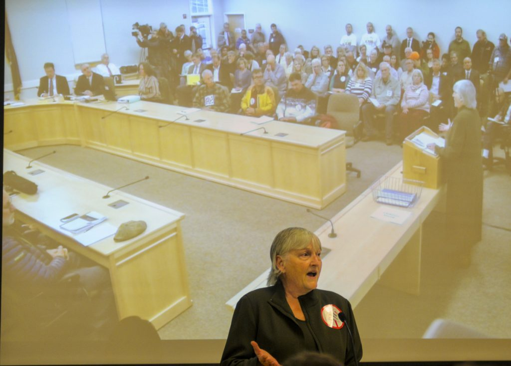 "Sheryl Harth of Jackman testifies against the CMP corridor proposal on Wednesday at the Maine Public Utilities Commission office in Hallowell. She said, ""Stay away from our wilderness."""
