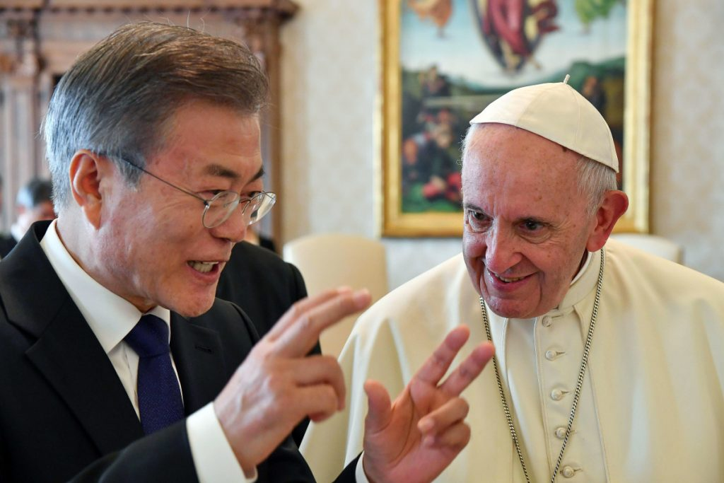 South Korean President Moon Jae-in talks with Pope Francis during their private audience at the Vatican on Thursday.