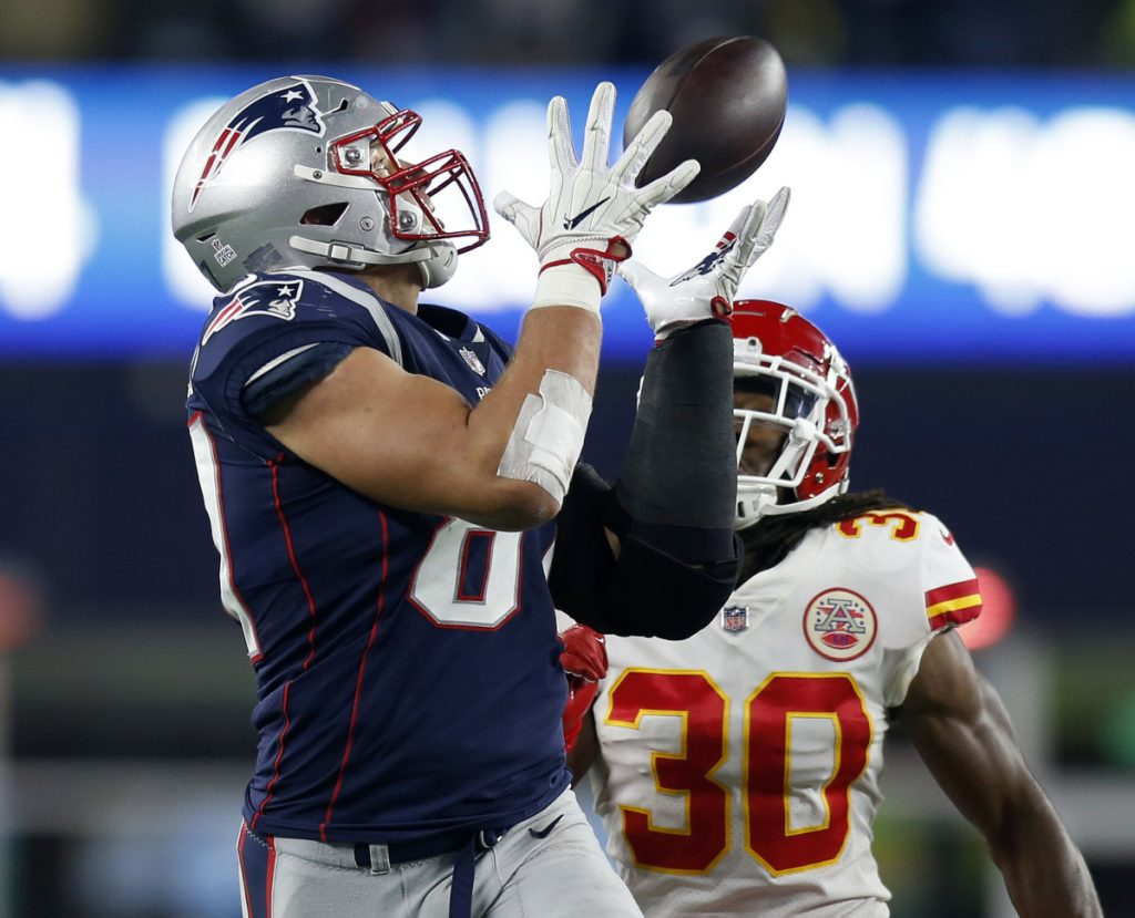 The New England Patriots listed tight end Rob Gronkowski as questionable for Sunday's game at Chicago, not just for a longstanding ankle injury but for the first time with a back problem.